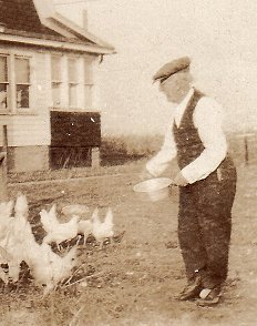 C. W. Netherwood feeding the chickens