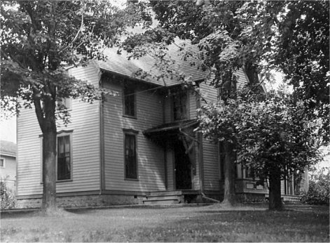 Exterior view of their two-story clapboard home