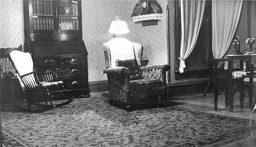 Another interior view with antique furniture and telephone